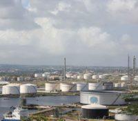 Cooper wil duidelijkheid over omkoping onderhandelingsteam raffinaderij